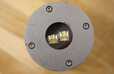 hardness: Cartridge case head split and mounted for hardness testing