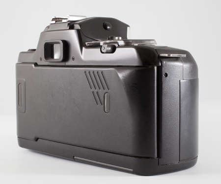 Back of a camera that took thirty five millimeter film on white
