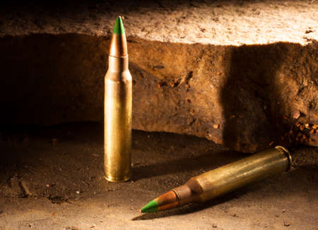 Pair of green tipped rifle cartridges some consider armor piercing