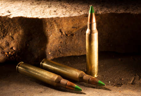 Rifle cartridges with a green tip that some consider is armor piercing