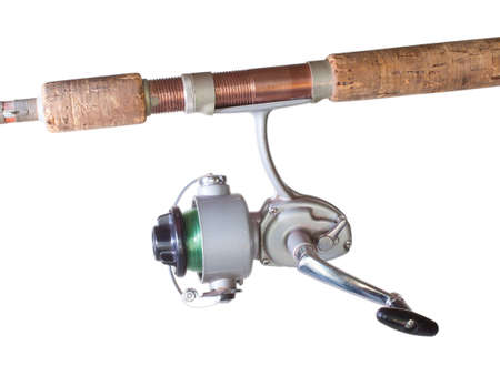 fiberglass handle: Old spinning reel with green fishing line and a rod isolated on white Stock Photo