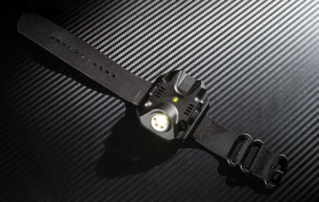 torchlight: Flashlight meant for use with a gun that mounts on a wrist