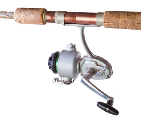fiberglass handle: Spinning reel made out of metal on a rod isolated on white