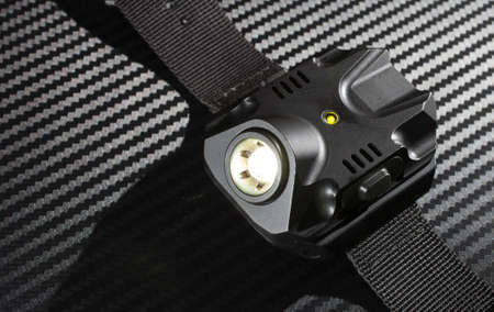 Tactical flashlight worn on the wrist that is on Banco de Imagens - 41813595