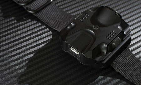 usb port: USB port used to recharge a flashlight worn on the wrist Stock Photo