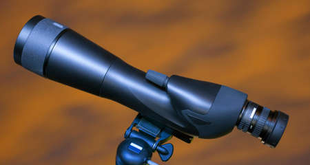 scope: High powered spotting scope with an orange and yellow sky behind
