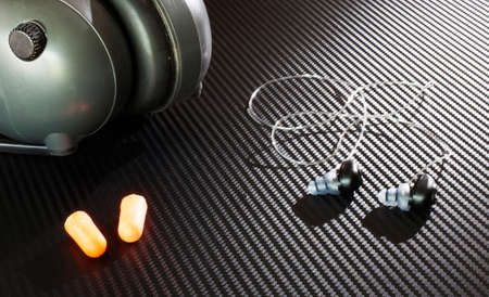 hearing protection: Three types of hearing protection for the shooting range on a graphite background