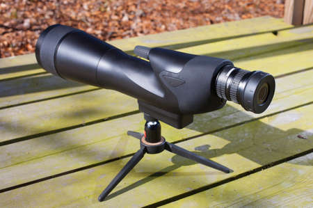 high powered: High powered spotting scope set up on a bench
