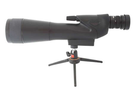 high powered: High powered spotting scope and small tripod isolated on white