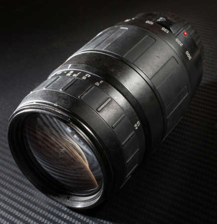 telephoto: Zooming telephoto lens that is used with modern digital cameras