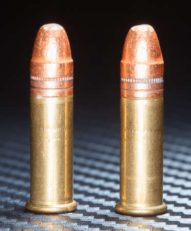copper coated: Copper coated bullets on cartridges designed for rimfire guns