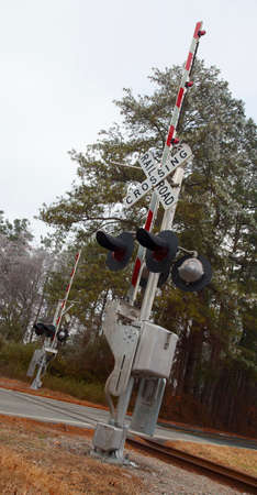 railroad crossing: Pair of railroad crossing signs on a small road