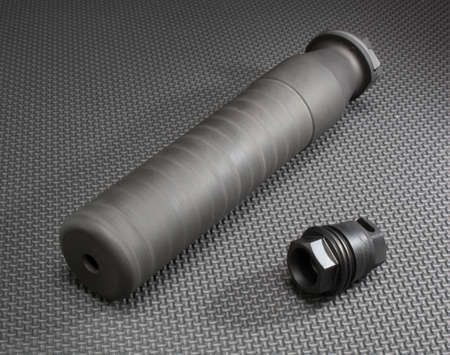 suppressor: Suppressor and the mount that holds it firmly on a rifle barrel Stock Photo