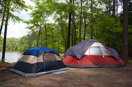 campsite: Two tents in a lakeside campsite as sunset approaches Stock Photo