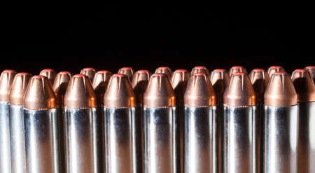 tipped: Cartridges designed for a thirty eight caliber handgun with polymer tipped bullets on black