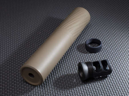 suppressor: Suppressor and adapter that holds it on a rifle barrel
