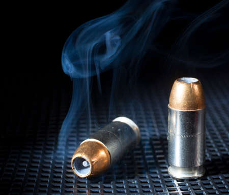 hollow: Pair of hollow point cartridges for a handgun and smoke
