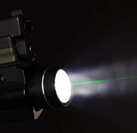 barrel pistol: Green laser and flashlight that are on a handgun Stock Photo