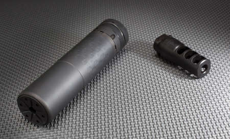 silencer: Rifle silencer and the mount that holds it on the barrel