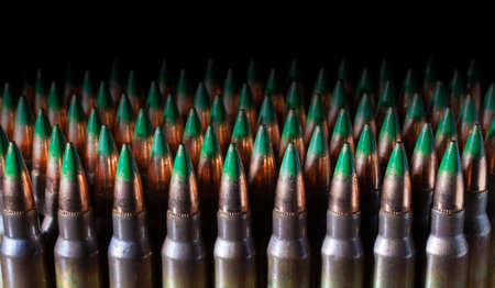 atop: Bullets with green tips atop a lot of rifle cartridges