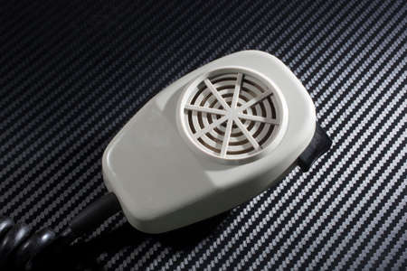 cb: White microphone that was used with an old CB radio