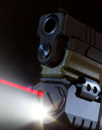 Red laser and white light coming from a pistol mounted unit