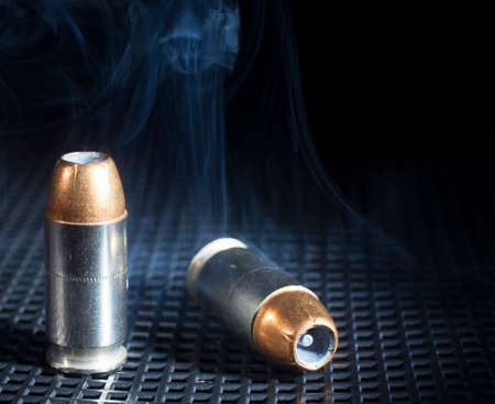 Smoke rising from handgun cartridges with hollow point bullets