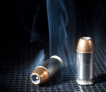 hollow: Handgun cartridges with hollow points and smoke