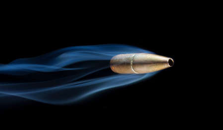 plating: Bullet with copper plating with smoke behind that looks like it is flying