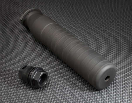 high powered: Adapter and suppressor that are used on a high powered rifle