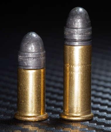 twenty two: Cartridges in two sizes designed for twenty two caliber firearms