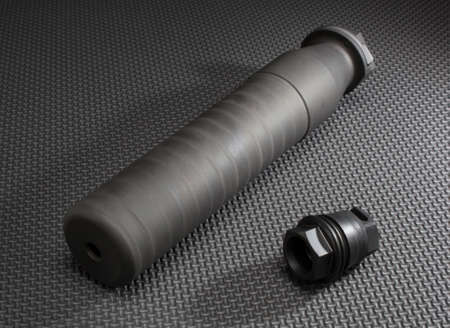 suppressor: Suppressor and the adapter that holds it to a gun