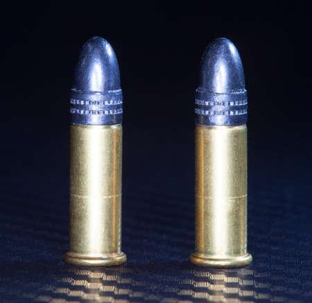 twenty two: Pair of cartridges for use in rimfire twenty two caliber guns