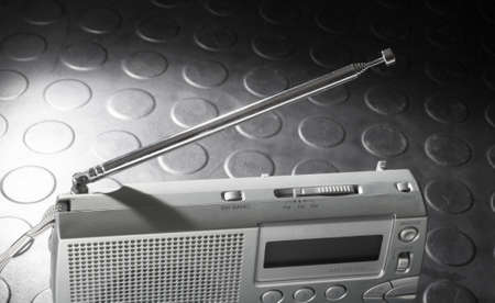 shortwave: Metal antenna on a battery powered radio designed to receive broadcast and shortwave Stock Photo
