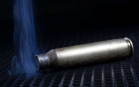 has been: Rifle cartridge that has been shot with smoke around