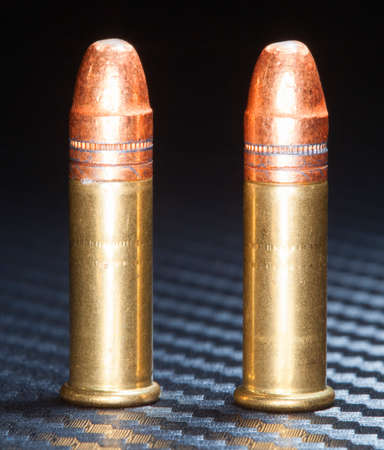 twenty two: Pair of cartridges that are designed for twenty two caliber firearms