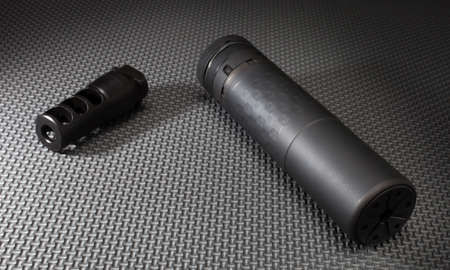 suppressor: Suppressor and the adapter that holds it on the barrel of a rifle