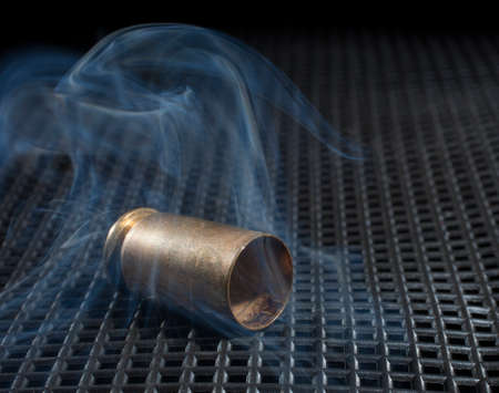 Smoke rising from a pistol bullet that has just been fired 版權商用圖片