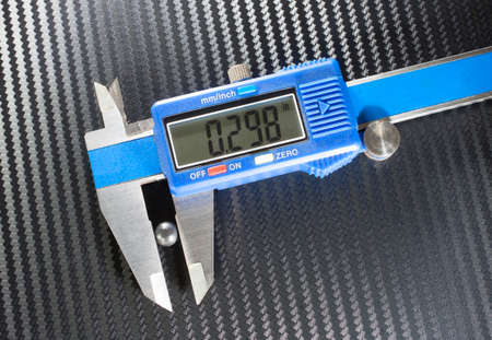 pellet: Digital caliper measuring a pellet from a shotgun