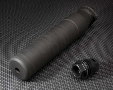 the silencer: Silencer and the adapter required to hold it on a rifle barrel Stock Photo