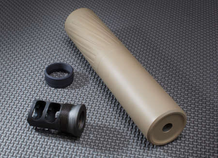 suppressor: Tan suppressor and gear needed to put it on a rifle