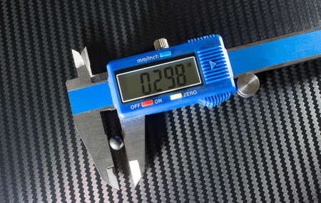bb: Digital caliper measuring a buckshot from twelve gauge shotgun ammo Stock Photo
