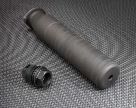 suppressor: Suppressor and the adapter required to hold it on a rifle