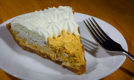 pumpkin pie: Pie with a whipped pumpkin filling and white cream on top Stock Photo