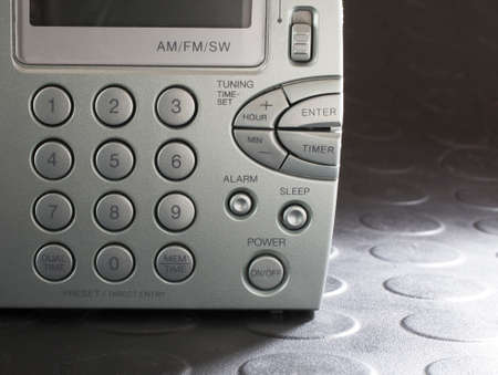 shortwave: Keypad on a battery powered radio that can receive broadcast and shortwave