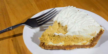 pumpkin pie: Pie that has a whipped pumpkin filling and white whipping on top Stock Photo