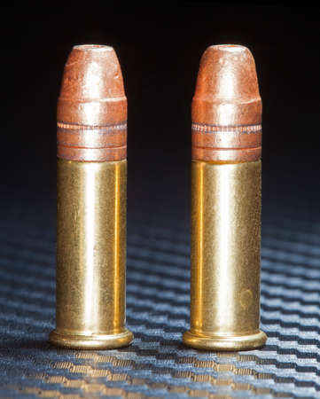copper coated: Cartridges for rimfire firearms with copper coated bullets Stock Photo