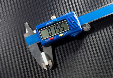readout: Digital caliper that is measuring the wad in a shotshell