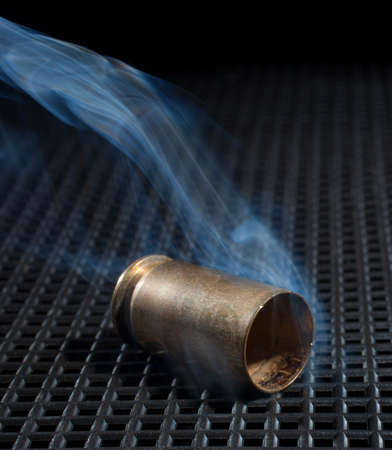 the casing: Casing that has been fired from a handgun that is smoking