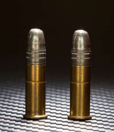 twenty two: Rimfire cartridges for a twenty two topped with lead bullets Stock Photo